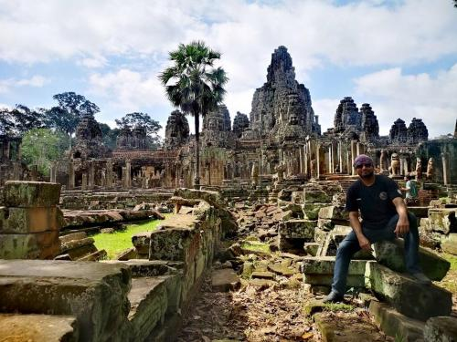 Angkor Wat is a temple complex in Cambodia and is the largest religious monument in the world. Originally constructed as a Hindu temple dedicated to the god Vishnu for the Khmer Empire, it was gradually transformed into a Buddhist temple towards the end of the 12th century.