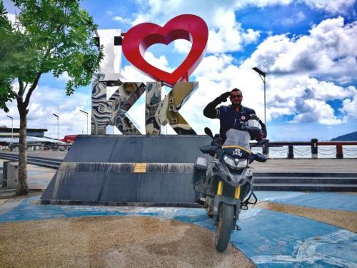 borneo-malaysia-ride-KK-city-sign-off